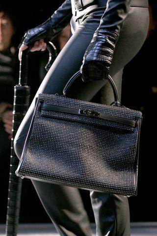 Black, Studded Kelly bag. Fall 2010 Hermes Runway Show, Paris.