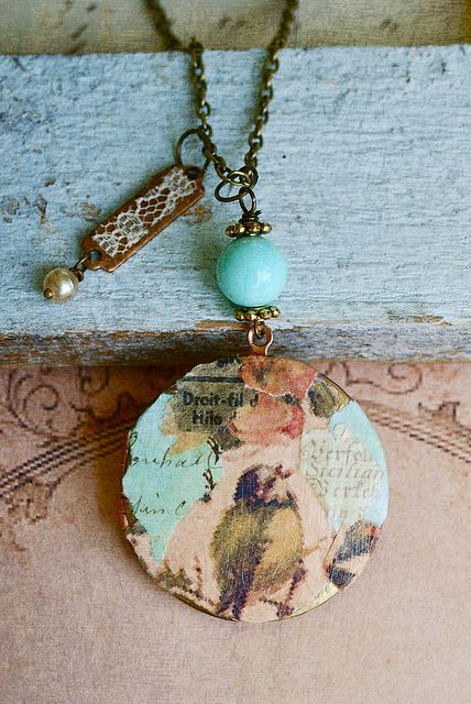 vintage bird collage locket Love the little bit of lace to soften the metal tag.