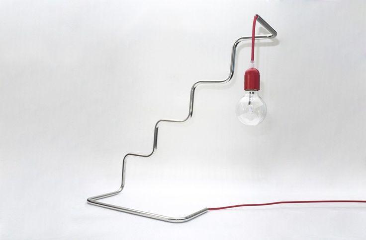 pietro travaglini creates tubino series of seemingly unstable lamps