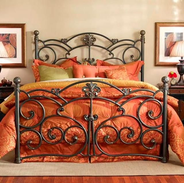 Detailed wrought iron bed frame and orange bedspread for Wrought iron bedroom furniture