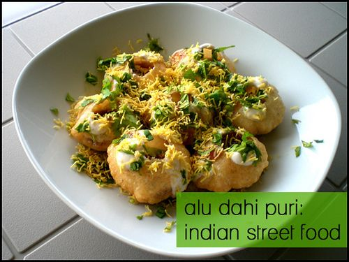 Alu Dahi Puri - a scrumptious, finger-licking street food. Bite-sized crispy morsels filled with spiced potato, yogurt and tangy chutney.