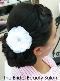 I love this style!  The braid is really cute, and the curl bun with flower is awsesome!