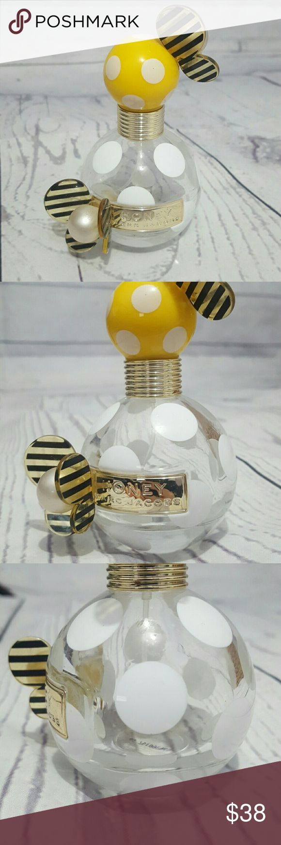 Marc Jacobs Honey 1.7 Fl. Oz Bee Perfume Bottle Bottle has some scratches and scuff marks but is in good condition. Has a small amount of product left. Great for a decoration! Marc Jacobs Makeup
