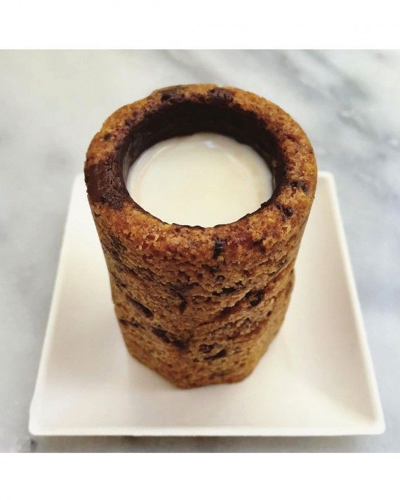 Another Dominique Ansel creation, the cookie shot is cookie in the shape of a shot class, coated with chocolate on the inside, and a shot of milk poured into the cookie. Drink the milk, munch on the cookie cup, there's no wrong way to eat this creative version of the classic milk and cookies dessert.