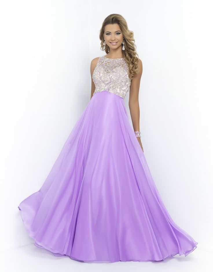 BLUSH PROM 9917 ORCHID Polished empire waist gown that is both sweet and sassy. Bodice features a nude satin sweetheart under a fully beaded sheer bateau style overlay covered in color coordinating beads and crystals with an open back. The full length A-line chiffon skirt will glide behind you in a soft train as you elegantly make your entrance. Back zipper closure. Available in Honeydew, Pool, and Orchid.