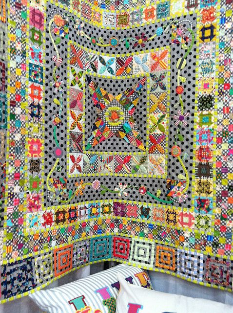 Jen Kingwell Designs Booth - Border Quilt with pieced and appliquéd work and recurring backgrounds.