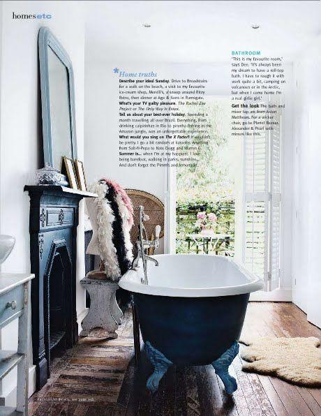 Clawfoot tub and fireplace in bathroom = dream bathroom