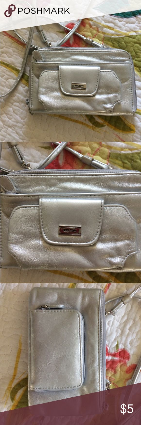 Silver leather crossover bag Extra long straps, silver leather, lots of pockets for cards, money, pics, etc. excellent condition. koltov Bags Crossbody Bags