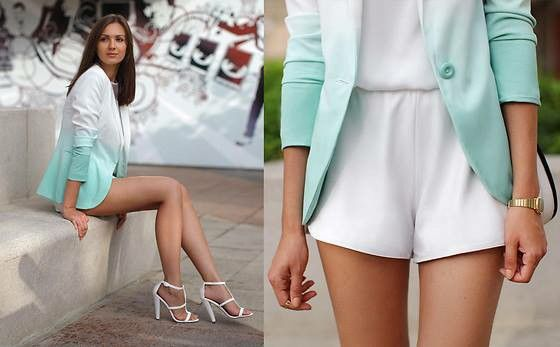 White short jumpsuit and a two tone blazer and with white sandles, a definite outfit for a day out with your partner