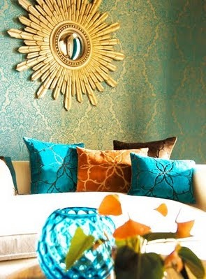 Harelequin wallpaper used beautifully in this room - love the orange accent