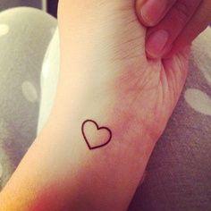 Heart - but filled in seafoam green - finger tattoo
