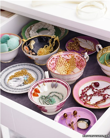 Tea cup jewellery organisation....I like the idea of pretty dishes where my earrings hang over the edge