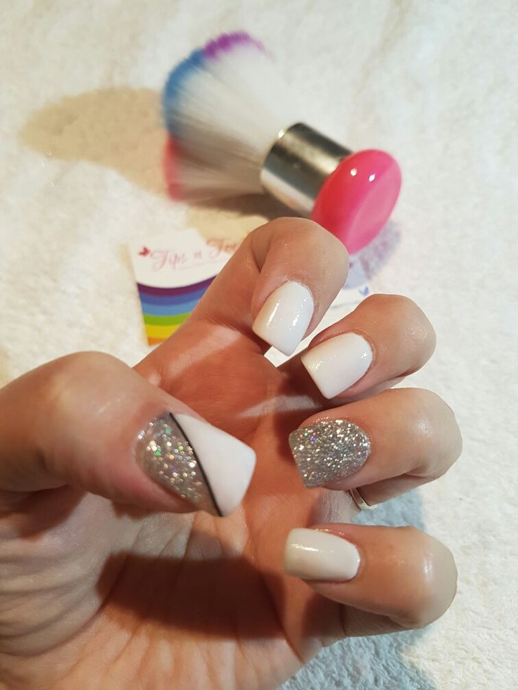 White and silver acrylic nails.   Blingy