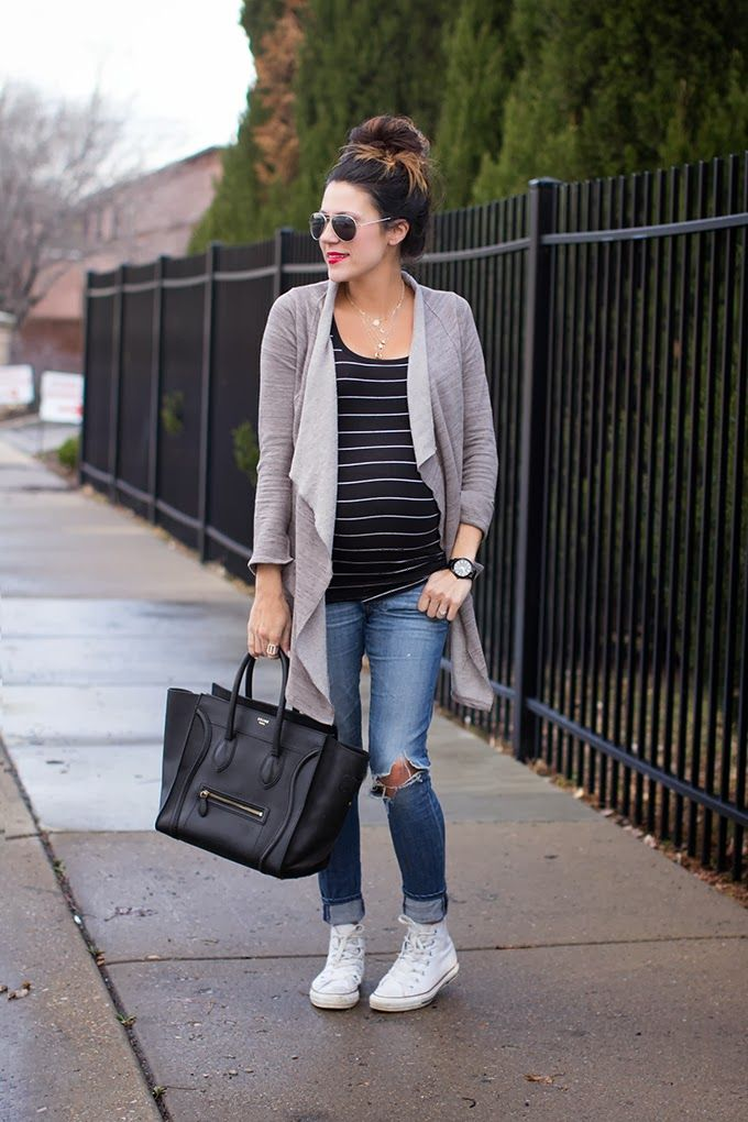 Such a perfect Spring outfit. A couple of layers, great pair of jeans some white Hi-top Chuck Taylors!