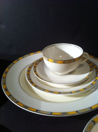 10 inch dinner plate,  7 inch plate,  4 inch berry bowl  and a 3 1/2 inch cup &  5 inch saucer. All have a beautiful golden yellow, black & gray floral border. This is The Chester pattern created by W H Grindley.
