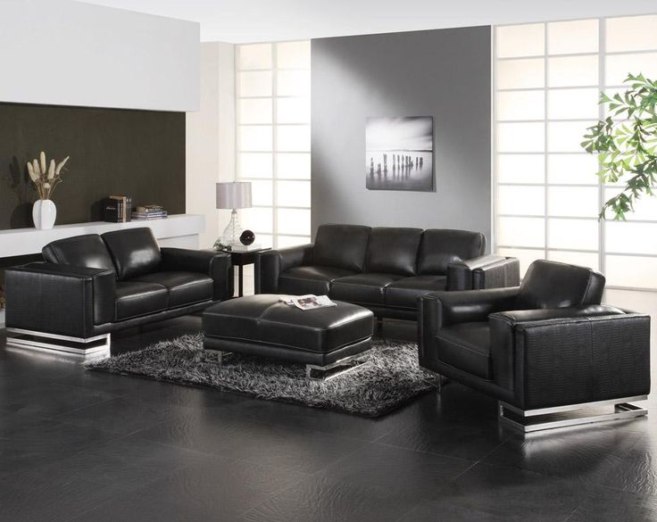 Enchanting Living Room Idea With White Wall Paint Color And Stunning Black Leather Sofa Set Also