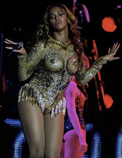 Hot or a bit too much? Beyonce at her Mrs Carter tour show onstage. The bodysuit was designed by Emilio Pucci.