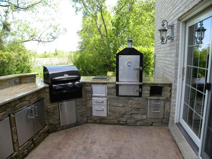 This outdoor kitchen includes a dedicated smoker.