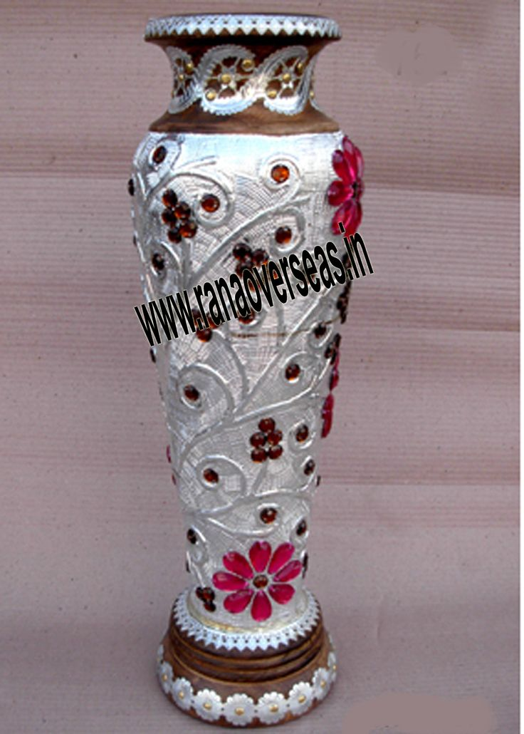 Wooden Flower vases are designed in styles ranging from exquisite to outrageous ones. These Flower vases chiseled out of variety of materials in varied shapes are extremely eye-catching with their compelling beauty. The Wooden flower pot base is made heavy to provide support to its body. Our flower pots have gained immense popularity worldwide. Wooden Flower pots are available in a variety of sizes, designs and styles.