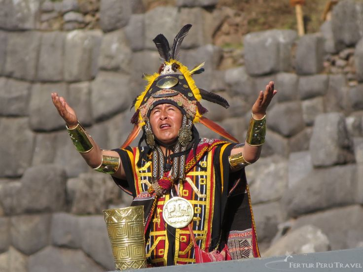 High priest makes salutation to the Sun during the re-enactment of Inti Raymi at Sacsayhuaman, Cusco, Peru.