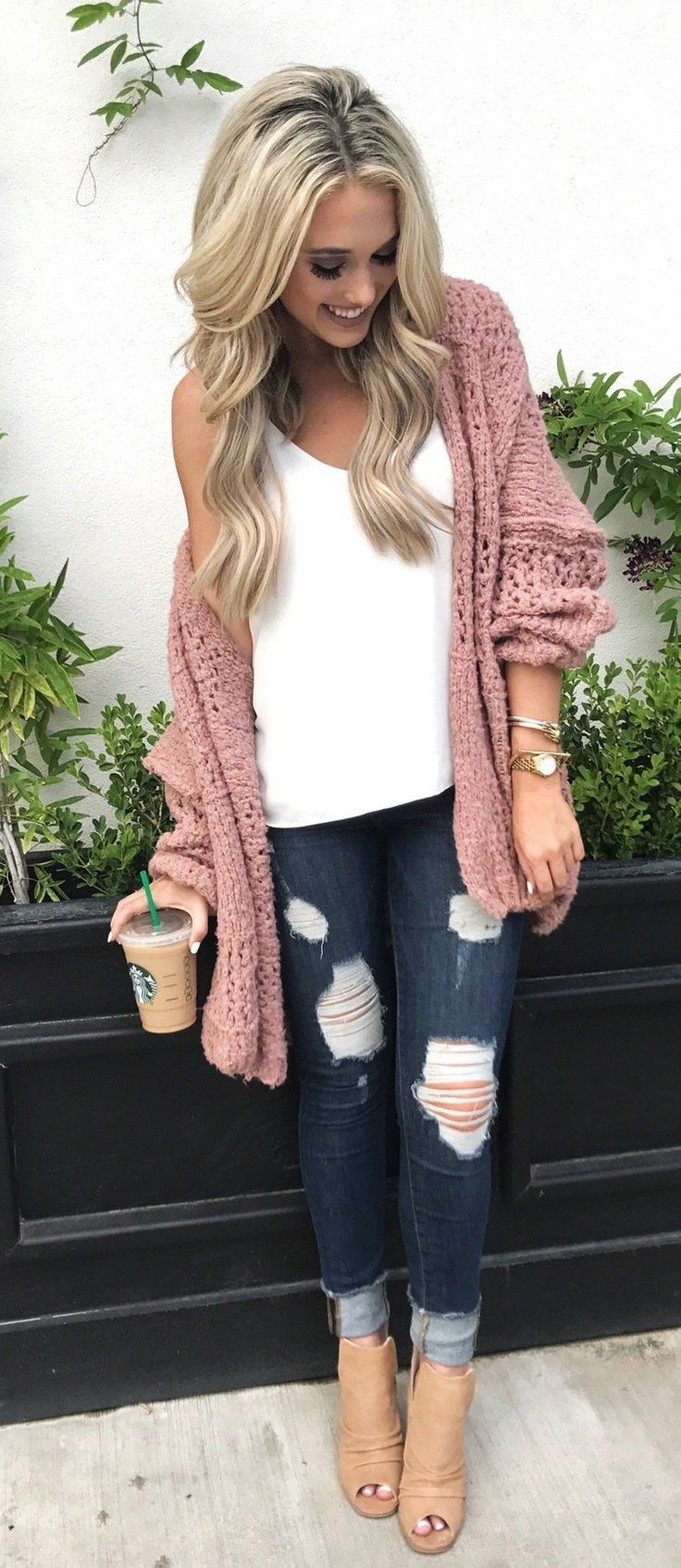 #winter #outfits women's pink knit cardigan, white top, blue distressed skinny jeans, and brown peep-toe heeled booties