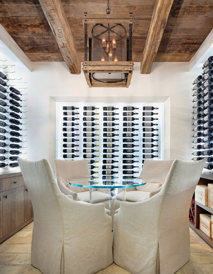 The wooden frame of this light fixture works well with the contrast of the modern wine cellar design.