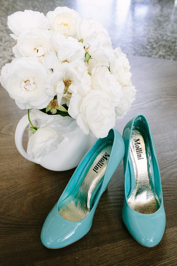 all-white bouquet and aqua wedding shoes, photo by Love Katie + Sarah http://ruffledblog.com/bellarine-peninsula-wedding #shoes #wedding #aqua