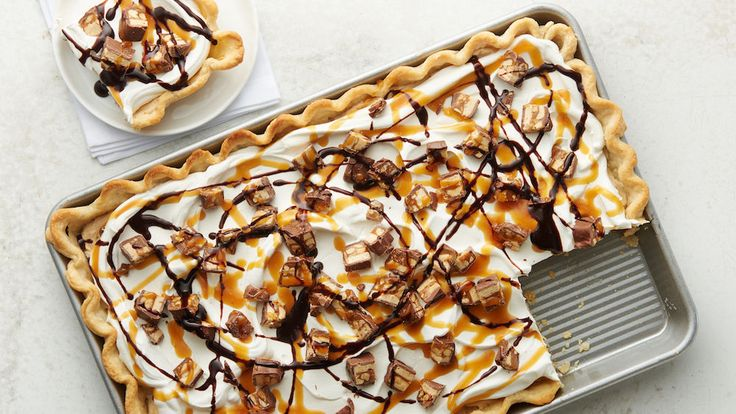 Snickers™ fans, rejoice. We pulled out all the stops on this dessert -- a giant slab pie made with peanut butter cream and crushed Snickers™ bars, and then drizzled with caramel and chocolate. And if you're one of the many folks who love to freeze their candy bars, try throwing a slice in your freezer!