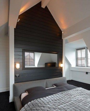 dark wall behind bed and headboard