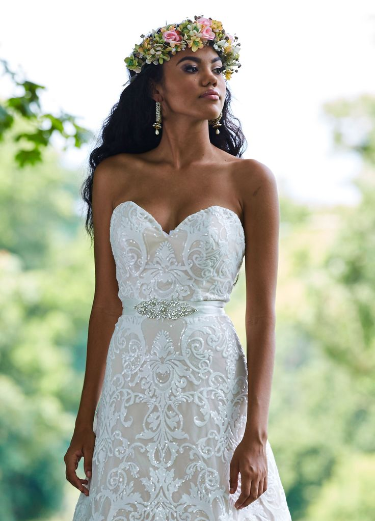 Beautiful strapless lace a-line with a little sparkle! Timeless and classic!