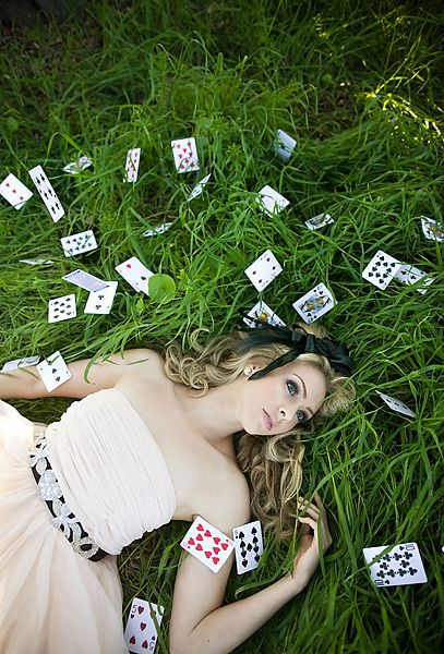 Alice in Wonderland theme. Cute save the date idea use cards with the date on them.