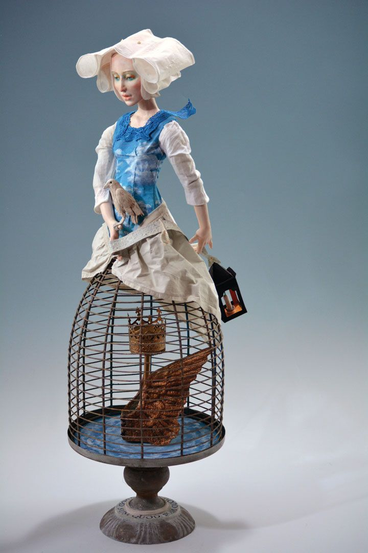 Inspired to reinterpret the traditional caged Santos figure, Karin Otto-Burfict filled the cage with symbols of personal development.   Art Doll Quarterly