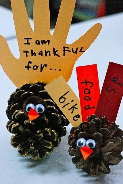 "Thanksgiving craft idea Pinecone turkeys. I would write ""I am thankful for"" on the palm and 5 things they are thankful for on the fingers. On white cardstock and they can color them. Also do something cuter w the face."
