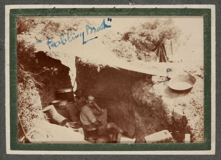 Australian Army Cooks in Dugout Kitchen, Gallipoli, Turkey 1915.  Cooking arrangements at Gallipoli were rudimentary with makeshift facilities. In this photo the cooks are set up in a deep unrevetted hole in the ground partially covered by a shelter structure and surrounded by pots, tins and boxes.  The caption 'Babling Brook' is rhyming slang for cook.  Photo by Trooper George Simpson Millar, World War I, 1915. Museum Victoria.