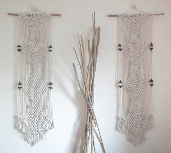 Bohemian fringed macrame wall hanging/display window decor with natural cotton rope and a tree branch. Minimal, ecological, modern