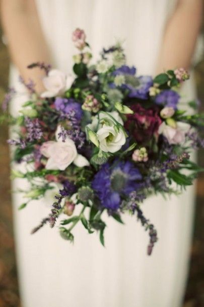 Close up of handtied bridal bouquet with dried lavender, lisianthus, scabiosa.   like the colours and the fact that its wild and loose structure (ie not a tight ball like some others)