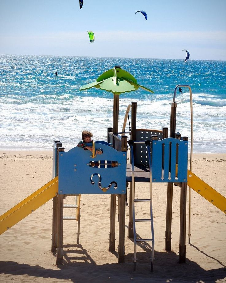 A playground for the kids & kite surfing entertainment for the parents! #familytravel #bestbeach