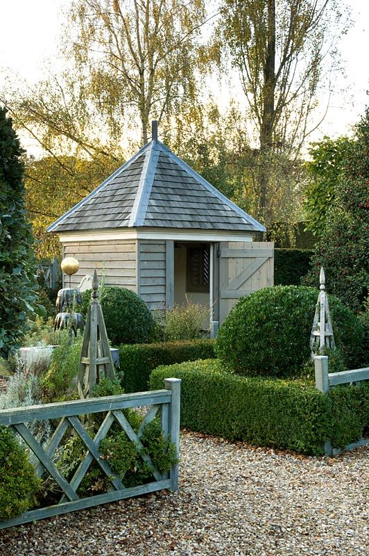 Potting shed & clipped boxwoods