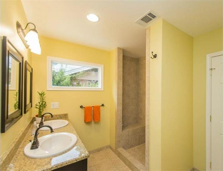 Soft Yellow Bathroom With Walk In Shower And Granite
