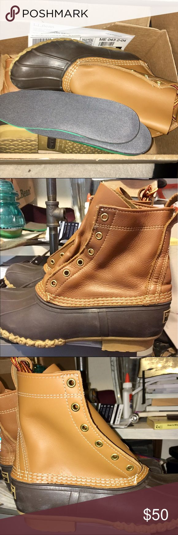 """Women's LL Bean duck boots 8"""" tall Women's LL Bean Duck Boots size 9 medium. 8 inches tall. Tan Leather with Brown Rubber. Also fit man's size 7. They are unisex boots.  Just returned by LL Bean. Bean replaced one of the leather uppers. Soles are not new but little wear on them. Brand new laces and inserts. This is a bargain for someone!  Ships in LL Bean box. Retail on boots from LL Bean website is $119.00. I ship within 1 business day of cleared payment. These run Large so please be…"""