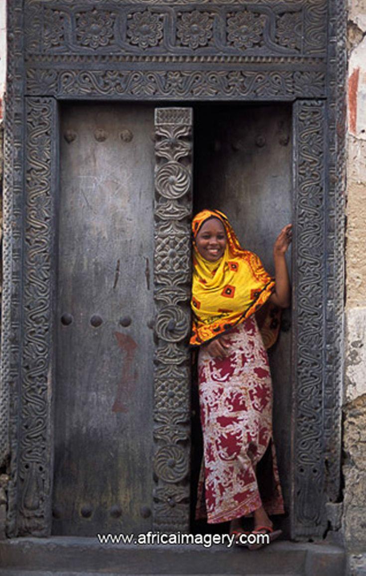 Africa | Swahili woman standing in a Zanzibar door ...