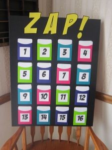"Zap Review Game...great because the ""smartest"" team may not win :)  IDK about the intentions of this game, b/c I haven't read the original link yet, but how cool/easy would it be to use this board for various reviews through out the year. Create questions on index cards to fit each topic and when you need to review a certain topic pull out the board with the corresponding topics and play."