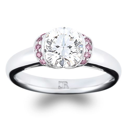 """Pretty in pink. """"Charme"""" features 10 fine pink brilliant cut diamonds, surrounding a round brilliant cut centre. This fully hand-made setting is available in 18"""