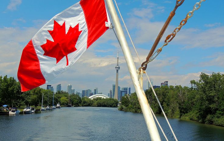 A glimpse of the CN Tower and Rogers Centre peeking through the waterways of the Toronto Islands as seen from from the upper deck of Mariposa Cruises Oriole. #Canadaflag #Toronto #Torontoharbour