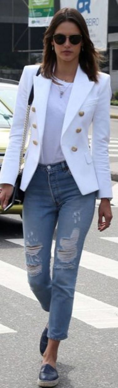 Alessandra Ambrosio: Sunglasses – Celine  Purse and shoes – Chanel  Jacket – Balmain  Shirt – Rta  Jeans – REdone