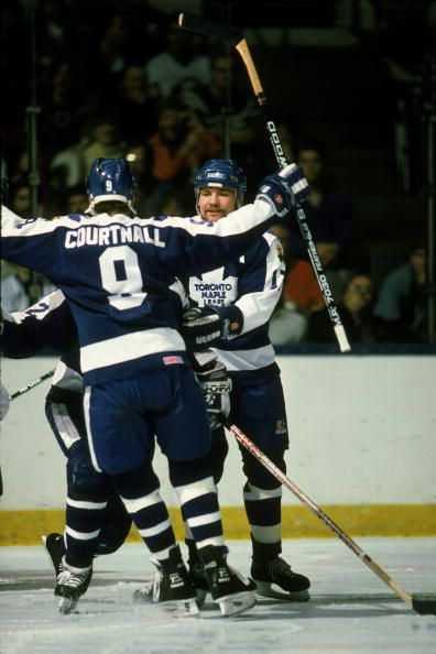 Canadian professional ice hockey players Russ Courtnall Wendel Clark of the Toronto Maple Leafs celebrate a goal on the ice during a road game...