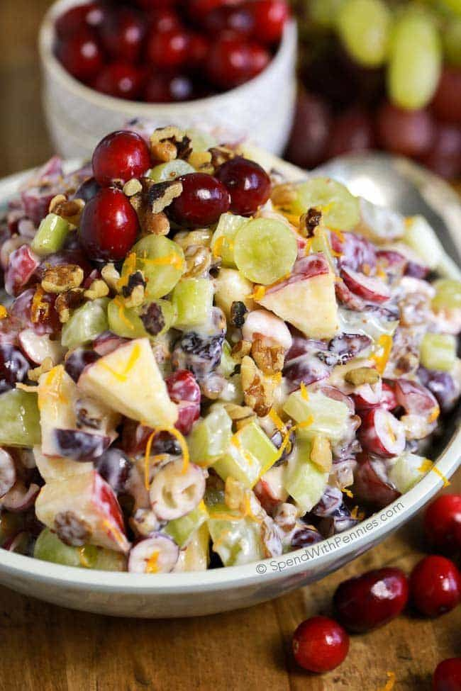 Cranberry Waldorf Salad has crisp apples, juicy grapes, crunchy celery and tart cranberries. This recipe contains no mayonnaise & uses yogurt instead.