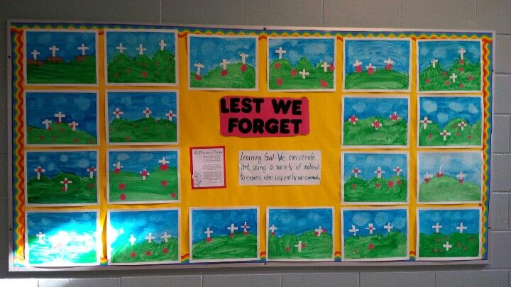 The Remembrance Day art we did in my class. Use painters tape to make the crosses and the border. Then the students paint over and peel back.