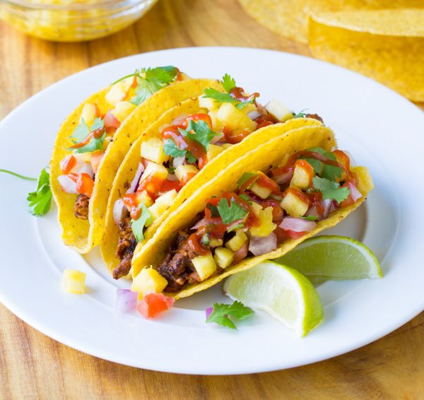 Easy authentic Tacos al Pastor Recipe with soft and crunchy tortillas. These spicy pork tacos bring home the flavor of central Mexico with fresh ingredients