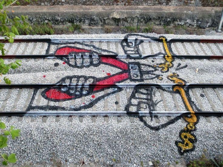 Colorful Street Art on the Train Tracks of Portugal by Artur Bordalo  http://restreet.altervista.org/artur-bordalo-usa-i-binari-della-ferrovia-come-tela/